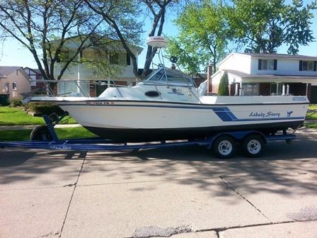 Used Celebrity 2500 Fish Hawk Cuddy Cabin Boat For Sale