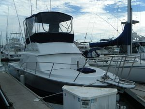 Used Phoenix 29 Convertible Flybridge Boat For Sale