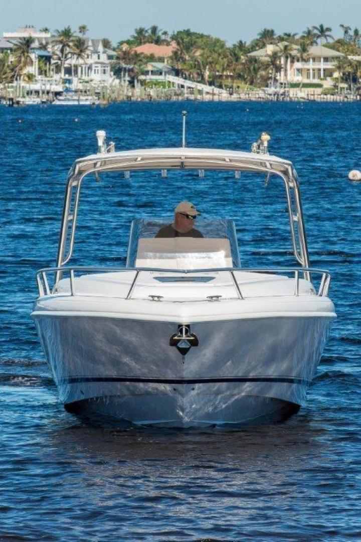 2005 used intrepid 323 cuddy center console fishing boat for Used fishing boats for sale in florida