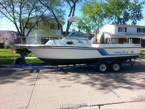 Used Celebrity 2500 Fish Hawk Cuddy Cabin Boat For Sale