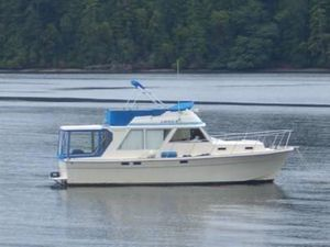 Used Trident Flybridge Boat For Sale