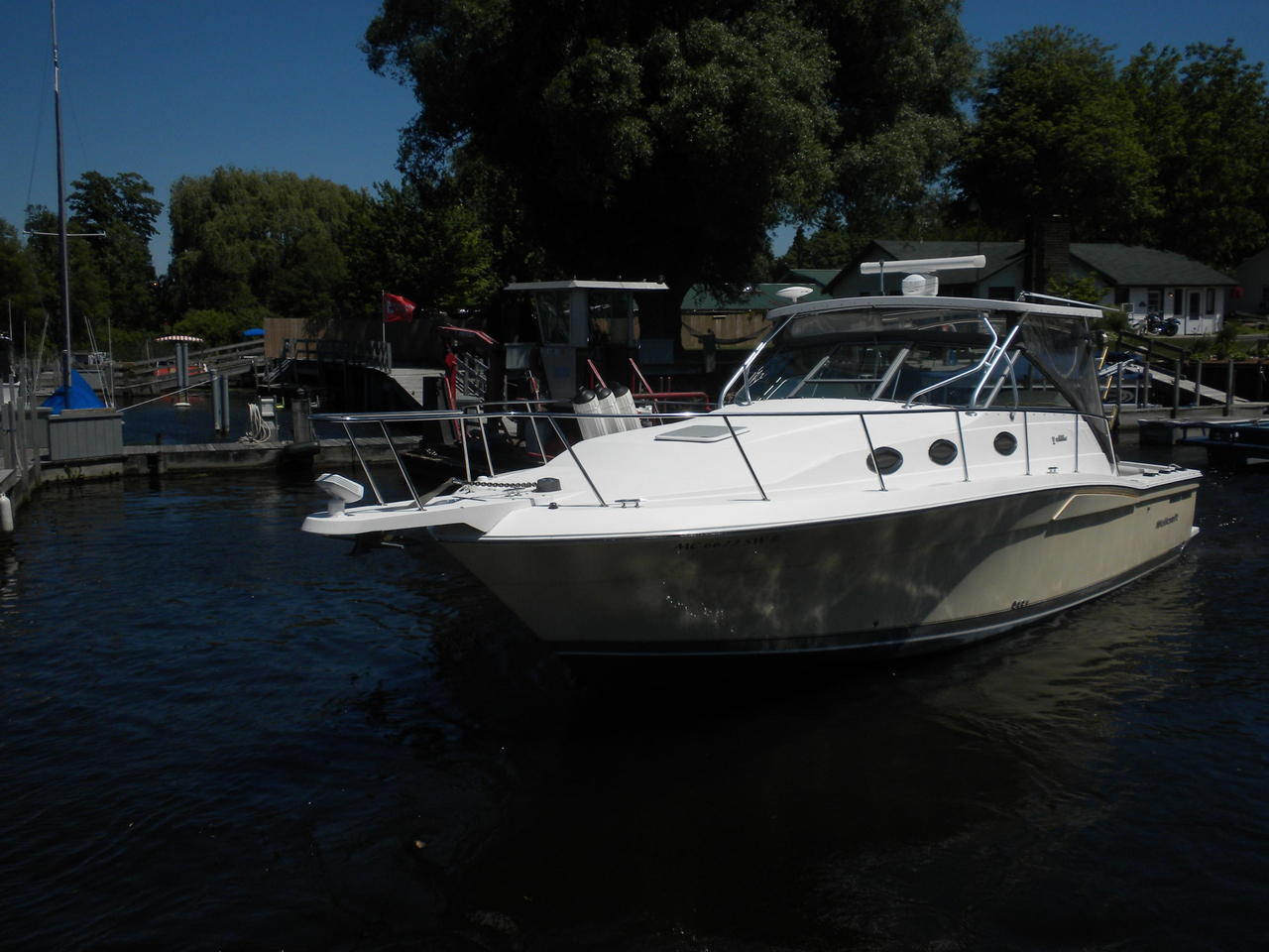 2005 used wellcraft 330 coastal convertible fishing boat for Fishing boats for sale in michigan