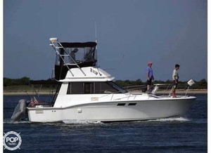 Used Trojan F-32 Express Cruiser Boat For Sale