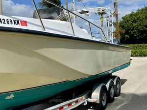 Used Boston Whaler 27 CC Cuddy Cabin Boat For Sale