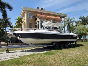 Used Intrepid 310 Walkaround Cuddy Cabin Boat For Sale