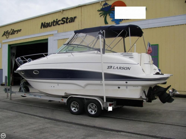 Used Larson 274 Cabrio Mid-Cabin Express Cruiser Boat For Sale