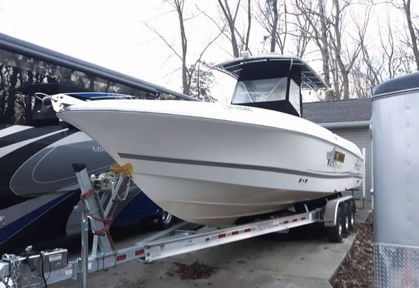 Used Wellcraft Scarab 32 CCF Center Console Fishing Boat For Sale