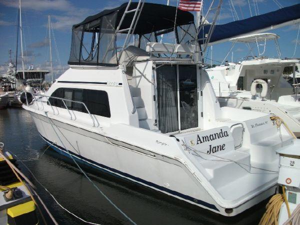 Used Mainship 40 Sedan Bridge Convertible Fishing Boat For Sale