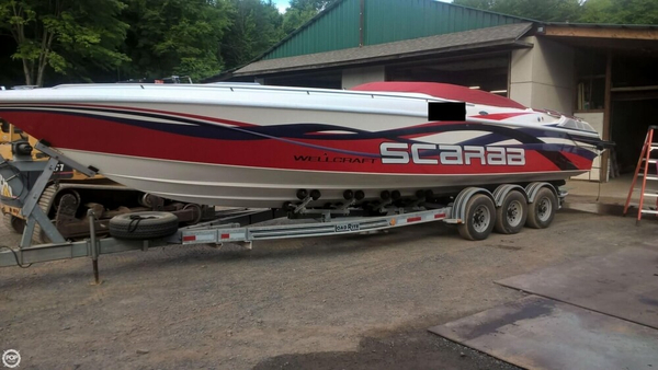 Used Wellcraft Scarab 31 Express Cruiser Boat For Sale