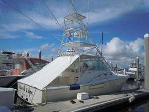 Used Rampage 38 Express with Tower Cuddy Cabin Boat For Sale