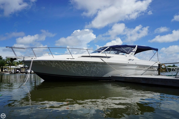 Used Wellcraft 3200 LXC Express Cruiser Boat For Sale